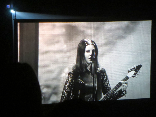 concert at acc toronto lana del rey singing playing guitar as seen on big video screen