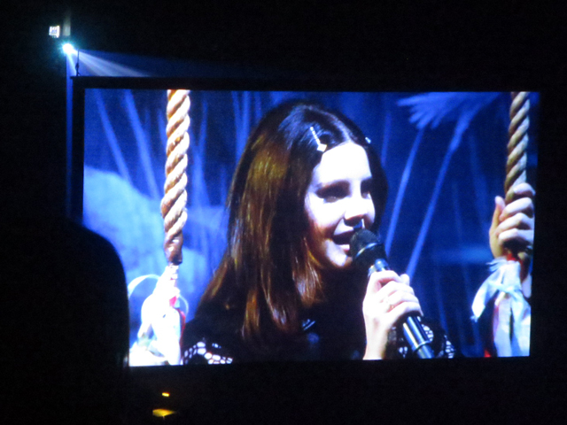 photo of large screen video lana del rey concert toronto acc lana on swing