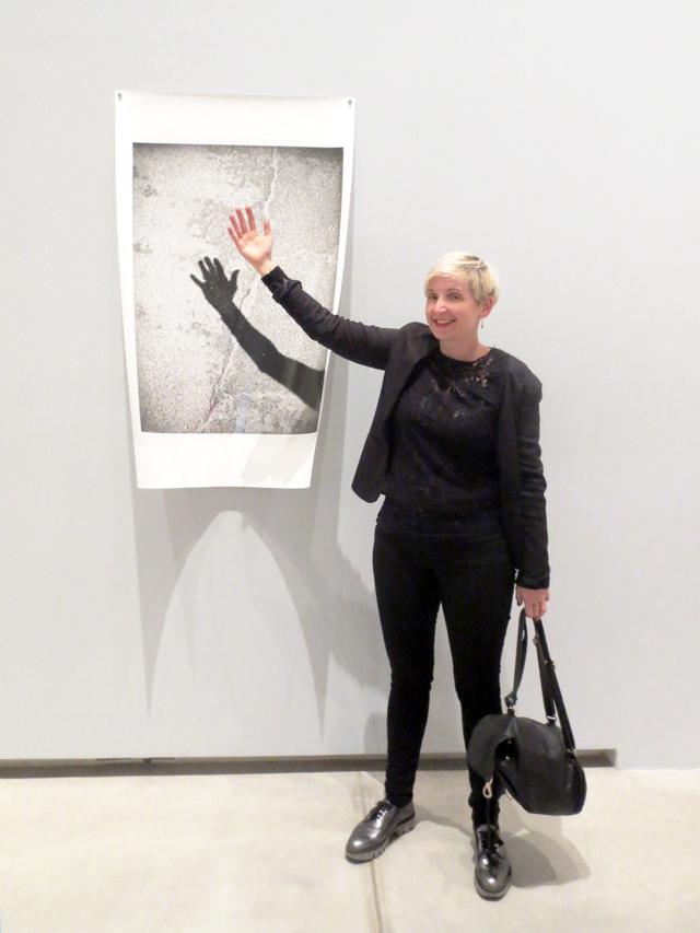 posing with photograph by liz johnson artur at ago aimia photography exhibition toronto