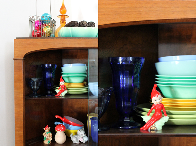 vintage christmas figurines and dishes in cabinet