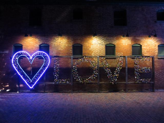 love sign at night toronto distillery distict