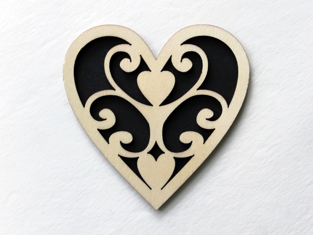 paper glued to wooden heart