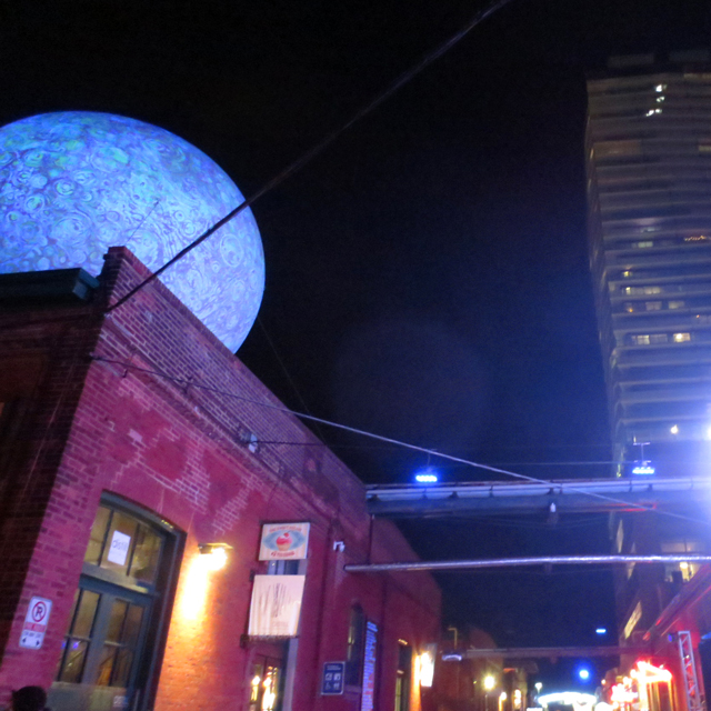 toronto distillery district at night during light fest moonburn installation by Stichting Barstow