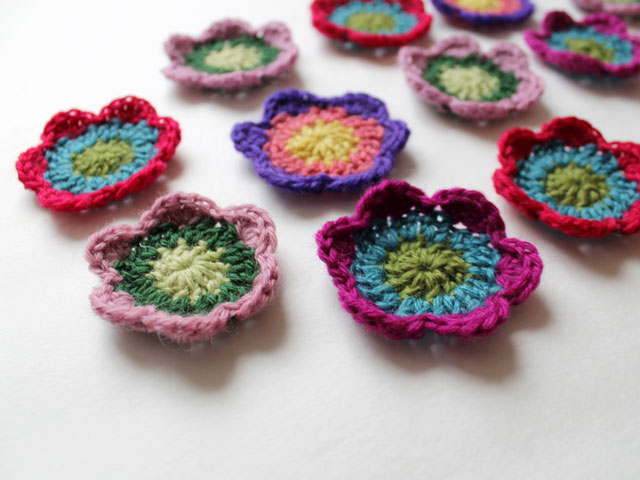 three round three colour easy to make small crocheted flowers