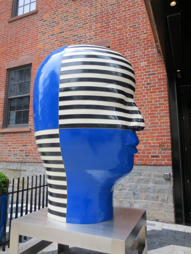 head sculpture outside bisha hotel toronto