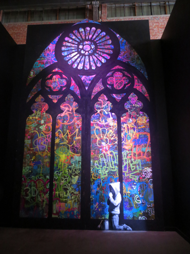 banksy boy praying stained glass artwork displayed in toronto