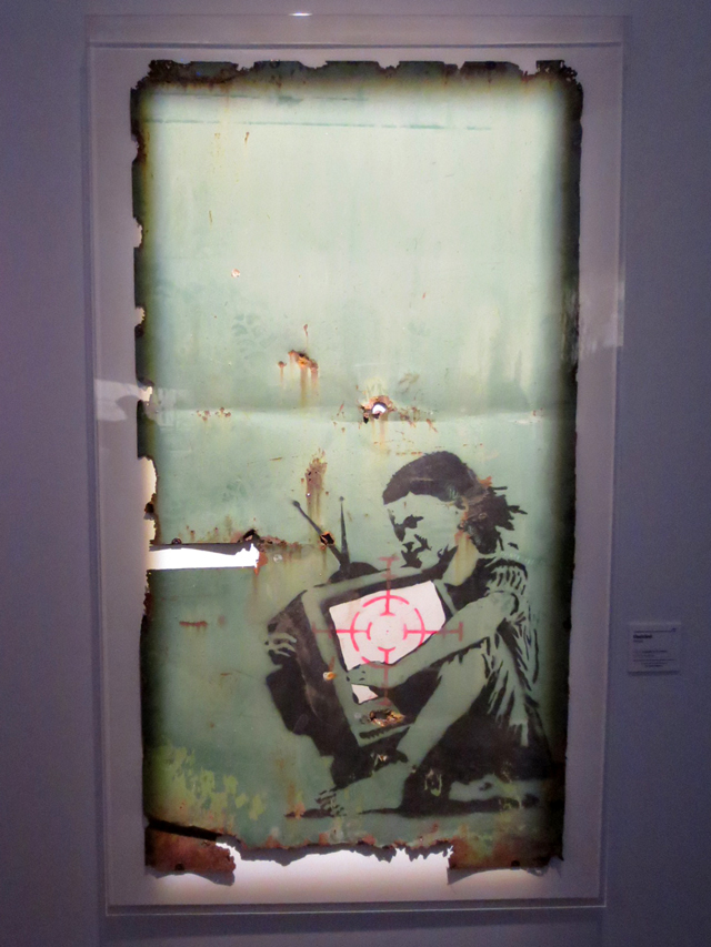 banksy graffiti artwork on display in toronto