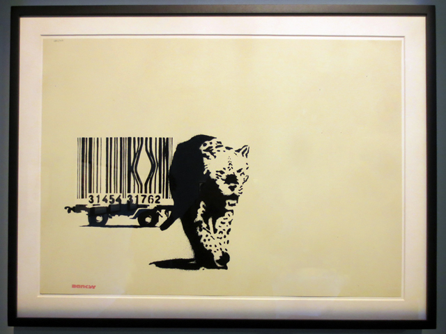 barcode by banksy artist print on display in toronto