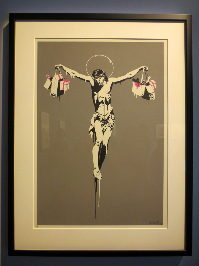 christ with shopping bags print on display in toronto exhibition