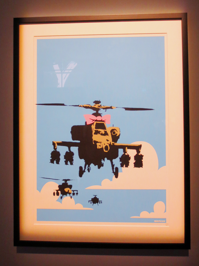 happy chopper banksy numbered print on display in toronto