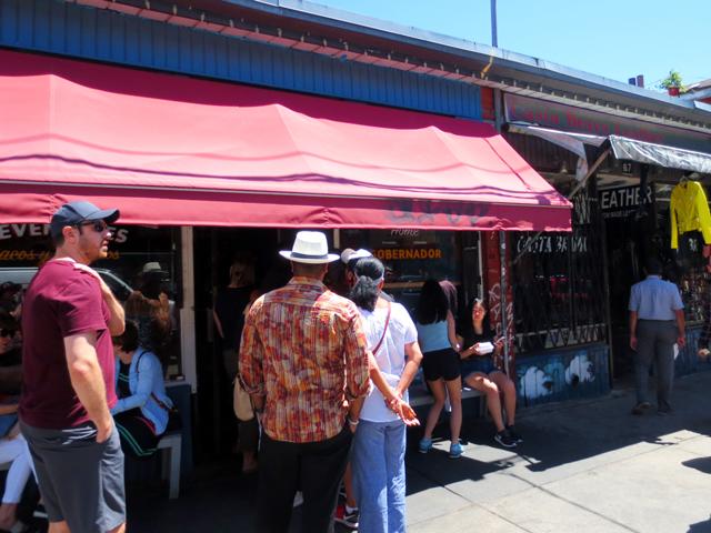line up at seven lives tacos kensington market toronto
