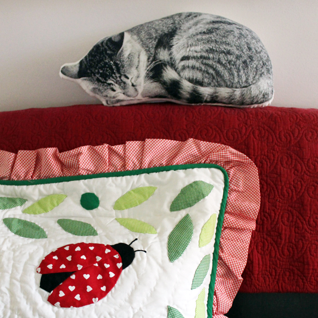 mixed textures decorating with textiles quilting cat pillow