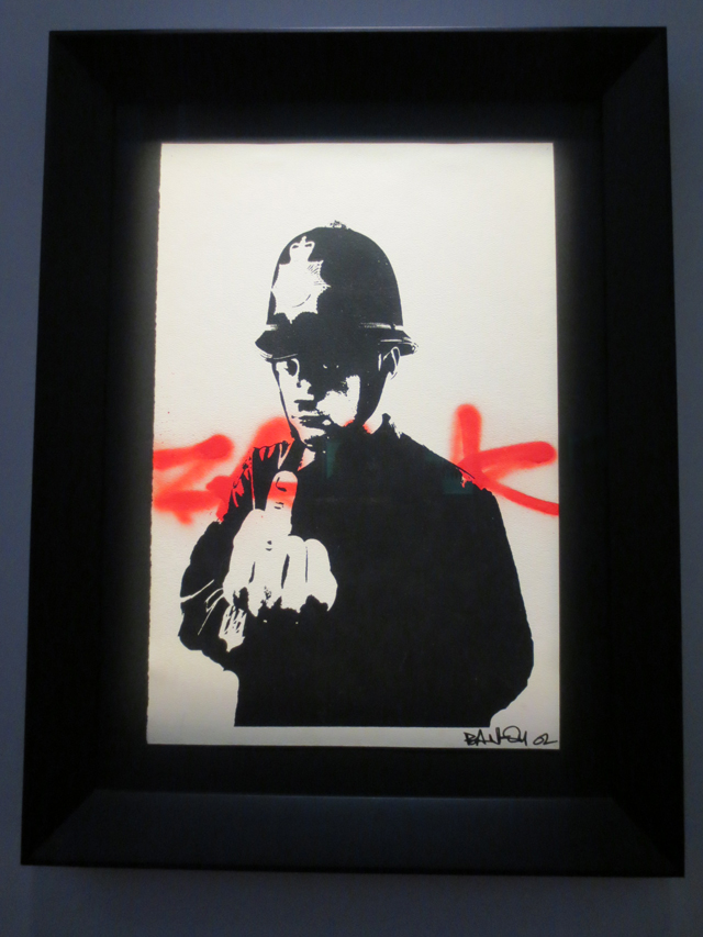 rude copper print by bansky on display as part of show in toronto