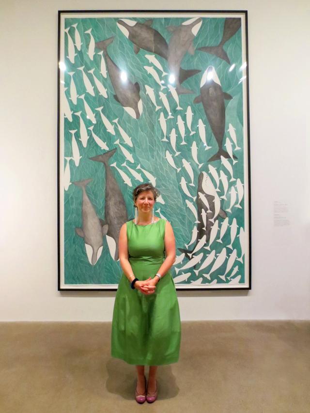 art gallery of ontario curator Georgiana Uhlyarik with drawing by Tim Pitsiulak