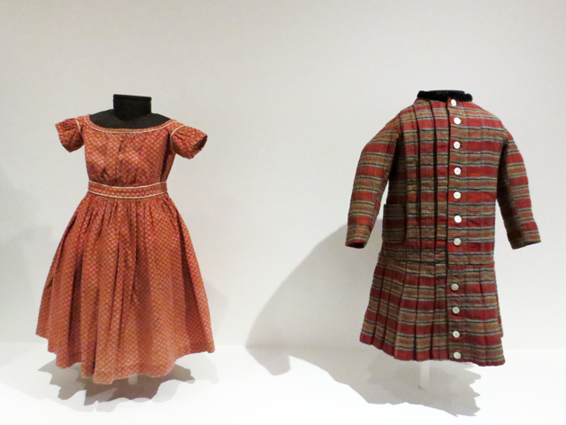 historic childrens clothing on display at textile museum toronto