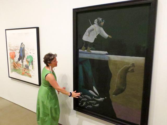 looking at the artwork of Tim Pitsiulak