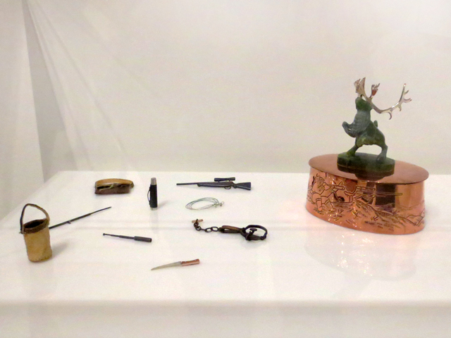 miniature sculpture caribou hunt by inuit artist Tim Pitsiulak at ago exhibition