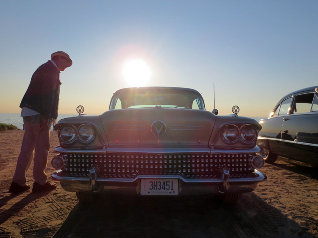 classic car show on sauble beach at sunset
