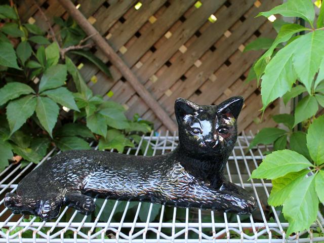 metal cat statue outdoor garden