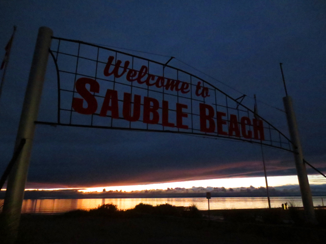 sauble beach sign at night