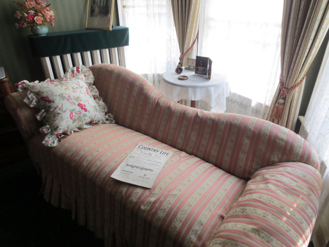 bedroom reading area with magazine from 1918