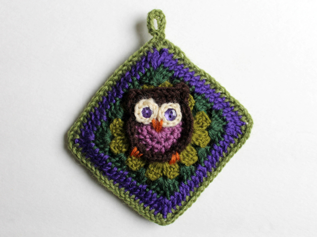 crocheted sacket by loulou using owl granny square pattern by sarah