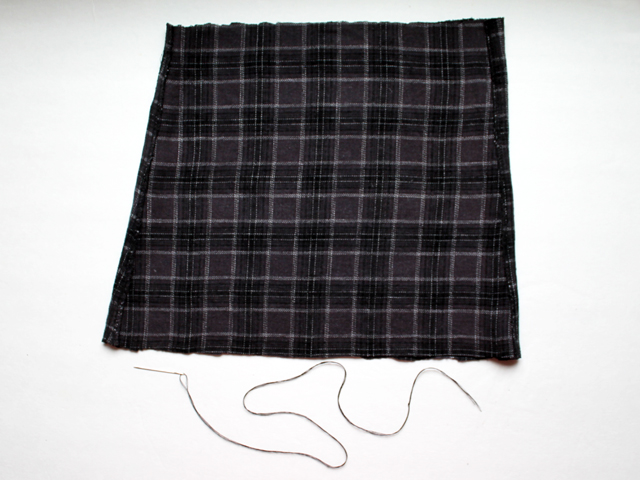 making it piece of old pajama leg and needle threaded with two lengths of thread