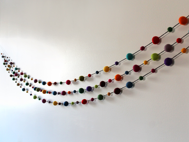 handmade garlands crafted with pur wool felted balls from michaels