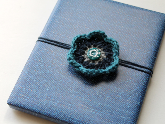 handmade crocheted flower gift topper with repurposed button wrapping decoration