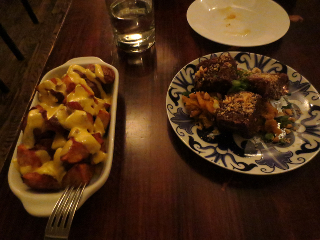 roasted potatoes with curry mayo and soy pork with housemade kimchi beast restaurant toronto
