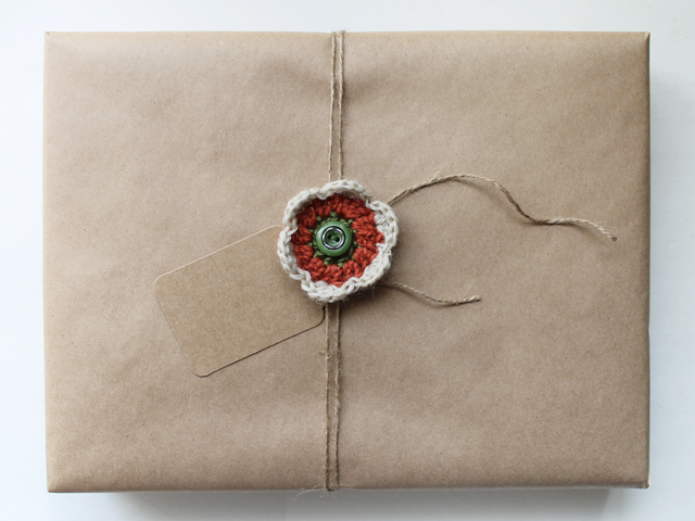 rustic gift wrapping with handmade crocheted flower alternative christmas wrapping