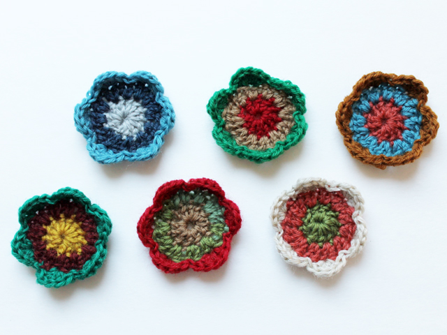 small three row crocheted flowers to use for making garland or gift topper free pattern