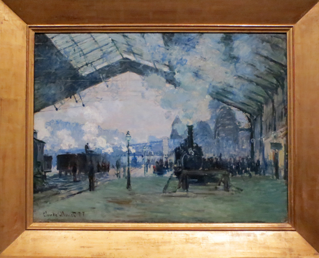arrival of the normandy train gare saint lazare by claude monet on display at ago impressionism in the industrial age exhibition toronto