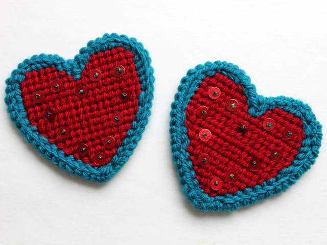 heart shaped plastic canvas from michaels completed with sequins added handmade valentine decorations