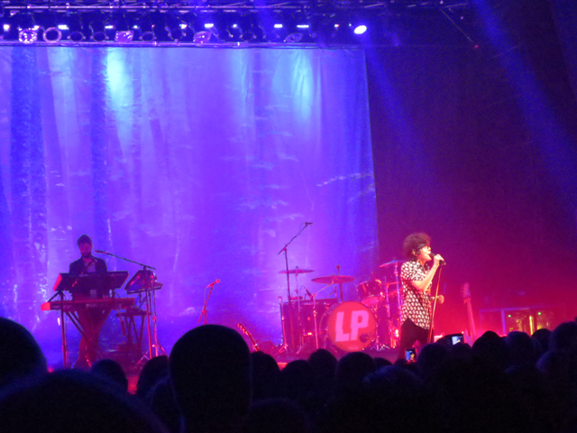 lp and piano player while performing recovery in toronto danforth music hall