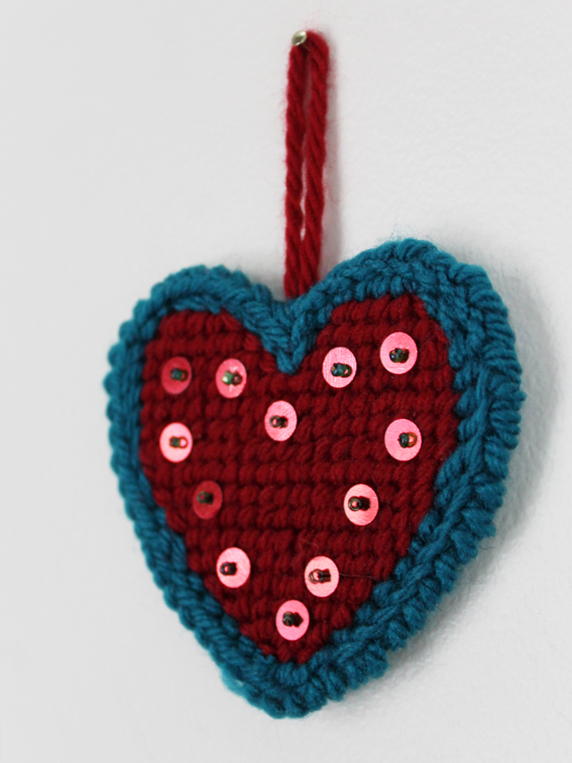 needle point on plastic canvas heart finished with sequins and a simple loop for hanging handmade valentine decoration