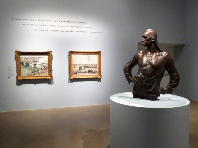 sculpture of longshoreman with camille pissarro paintings impressionism in the age of industry exhibition at ago toronto