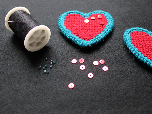 supplies to make valentine decoration needle point heart on plastic canvas with sequins and beads