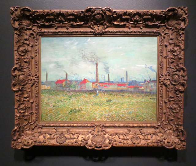 van gogh painting factories at clichy on display in impressionism in the age of industry exhibition at ago toronto