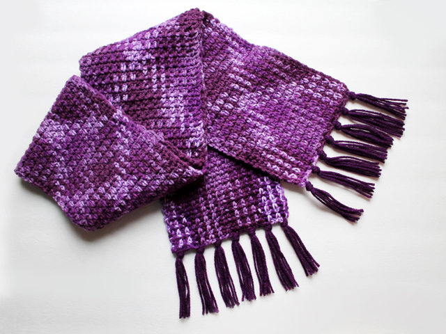 crocheted scarf using loops and threads pooling yarn purple plush colourway with added fringe
