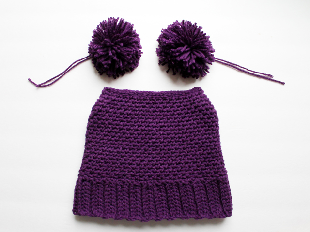 crocheting a hat for a girl with two pompoms