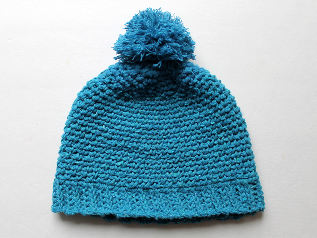 crocheted cotton hat with pompom for an infant baby free pattern