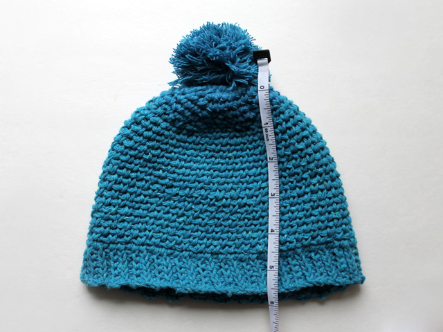 crocheted infant baby hat with pompom light cotton