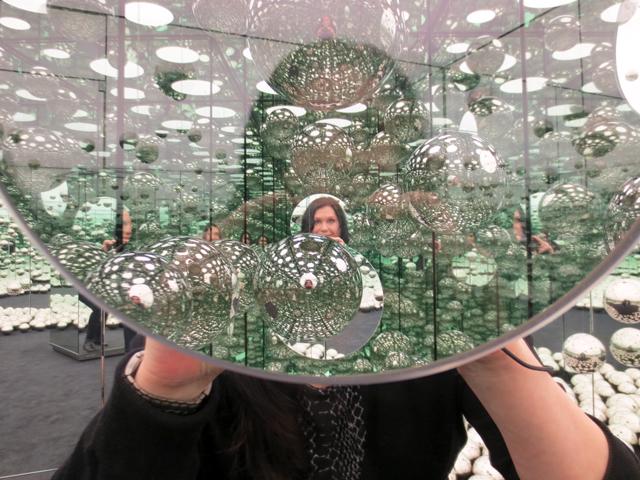 looking through peephole in yayoi kusama infinity mirror room ago toronto art gallery of ontario