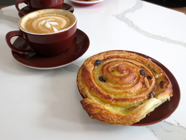 cappuccino and pastry at wallace espresso on king street west
