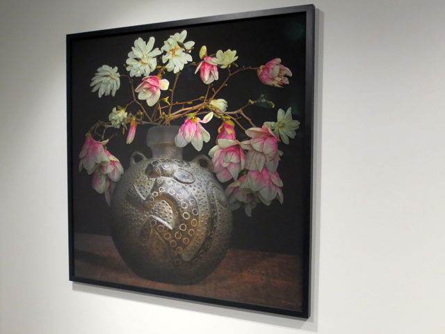 flowers in an ancient vase two photos joined together by tm glass at onsite gallery toronto contact photography festival