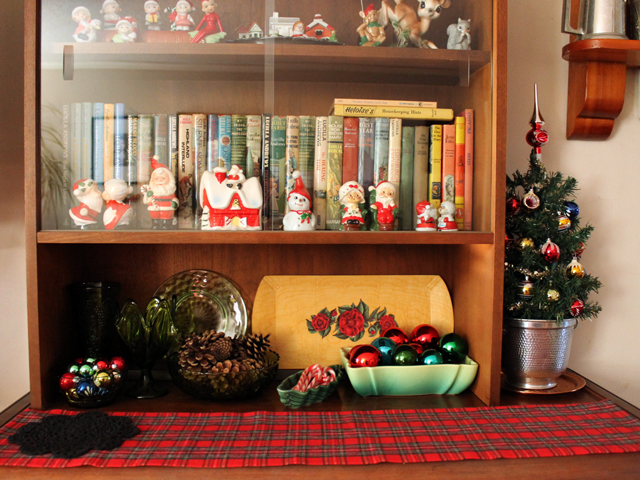 vintage christmas decor cabinet with figurines
